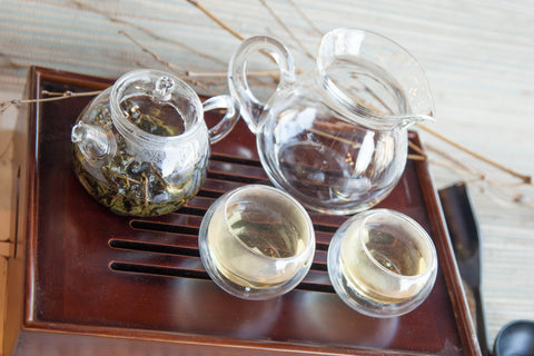 Preparing tea Gongfu style on traditional tray