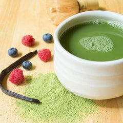 Cup of matcha tea with berries