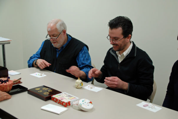 All of us taking some of the traditional sweets that accompany a Japanese tea ceremony