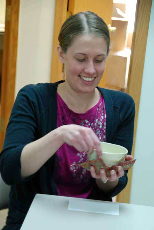 Sarah, learning to turn the bowl.