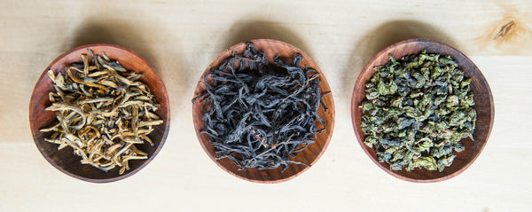 How to make tea - three bowls of loose leaf tea.