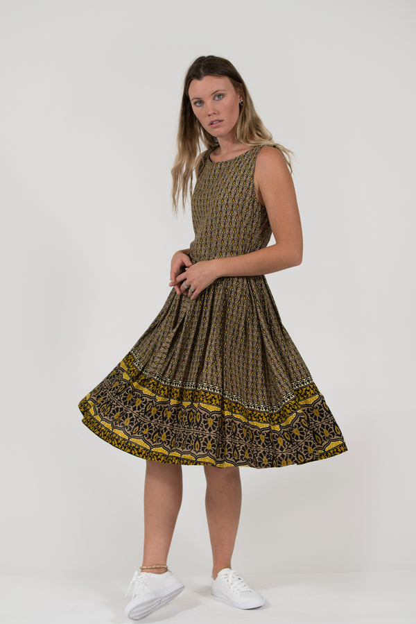 Isabella fit and flare dress yellow art deco border print pleated skirt