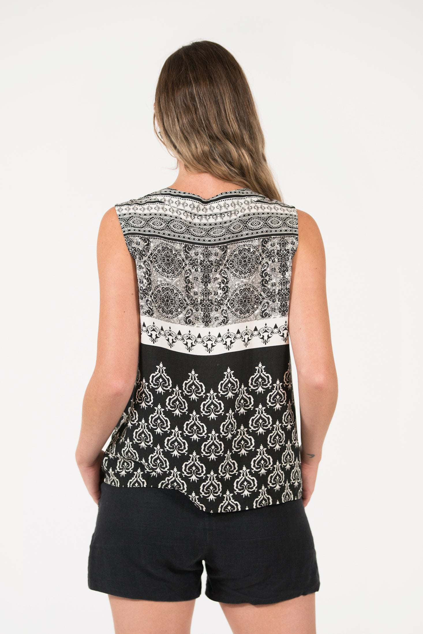 Black Heart printed sleeveless Bowline top with tie at neck