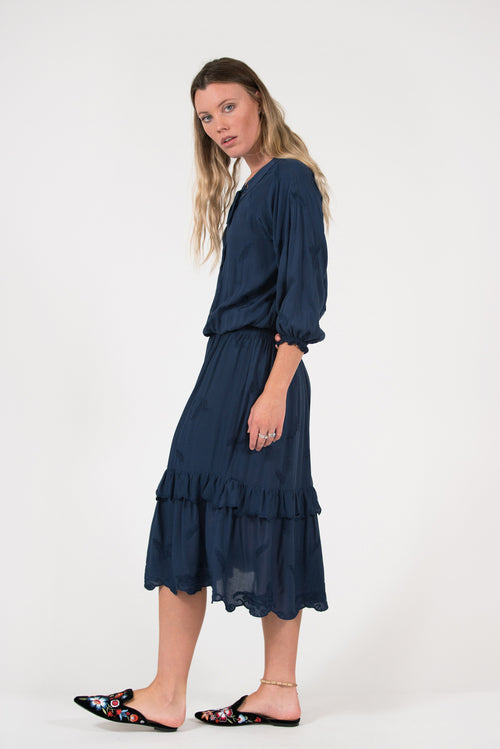 Navy embroidered dress with shirring and eyelets