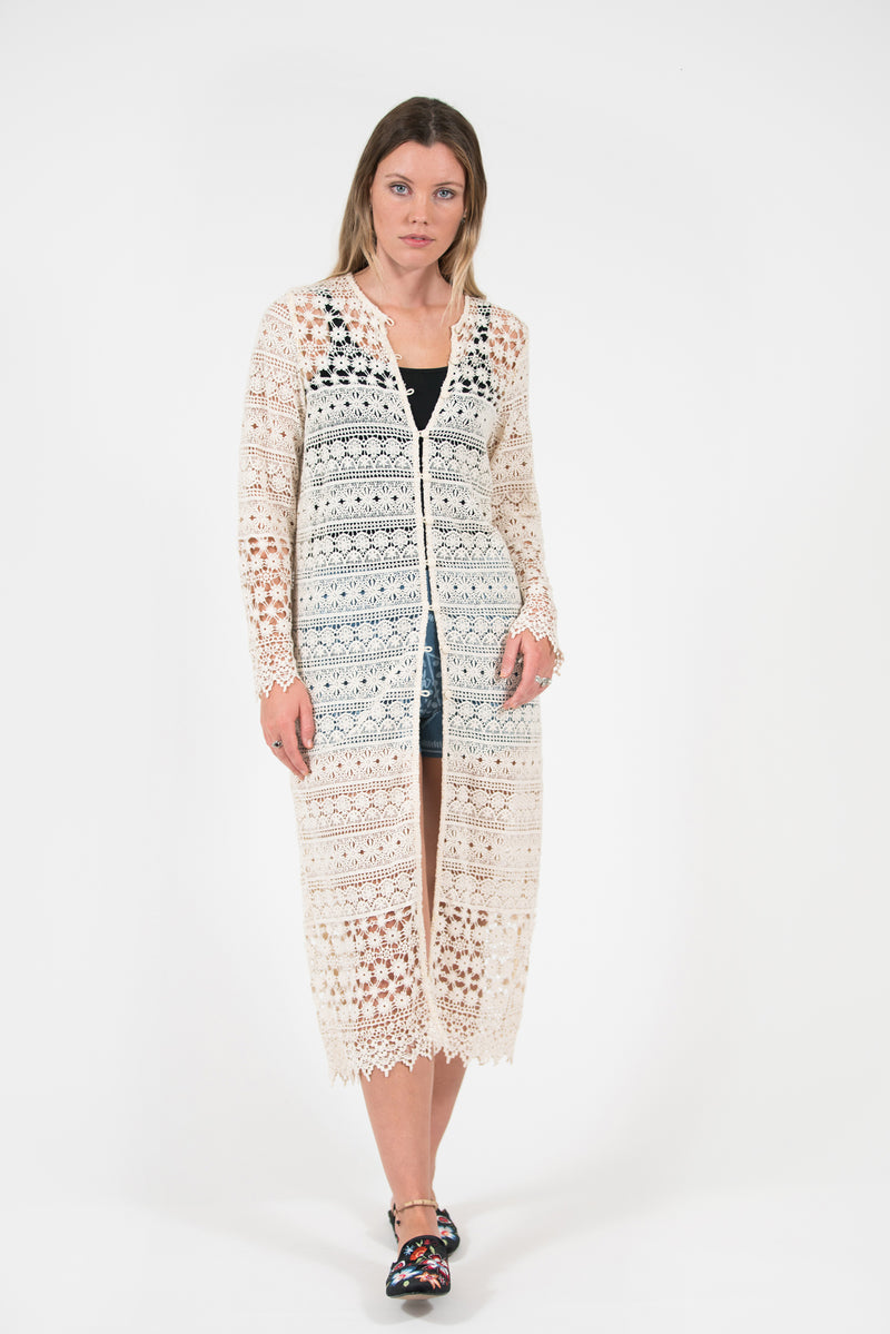Quinns lace crochet cream coat with covered buttons and scalloped edge