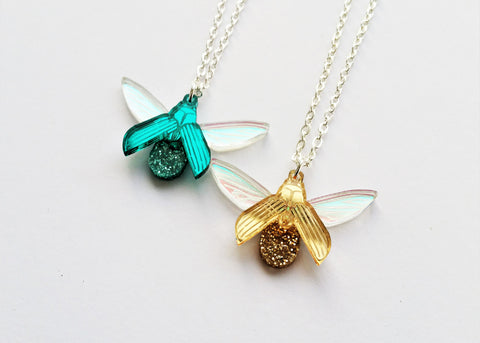 teal and gold glitterbug pendants