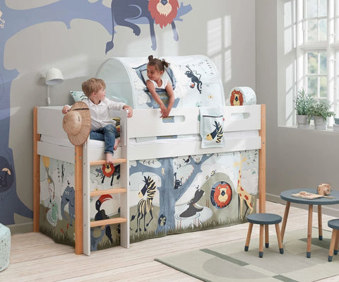 Mid height bed with safari theme fabrics.