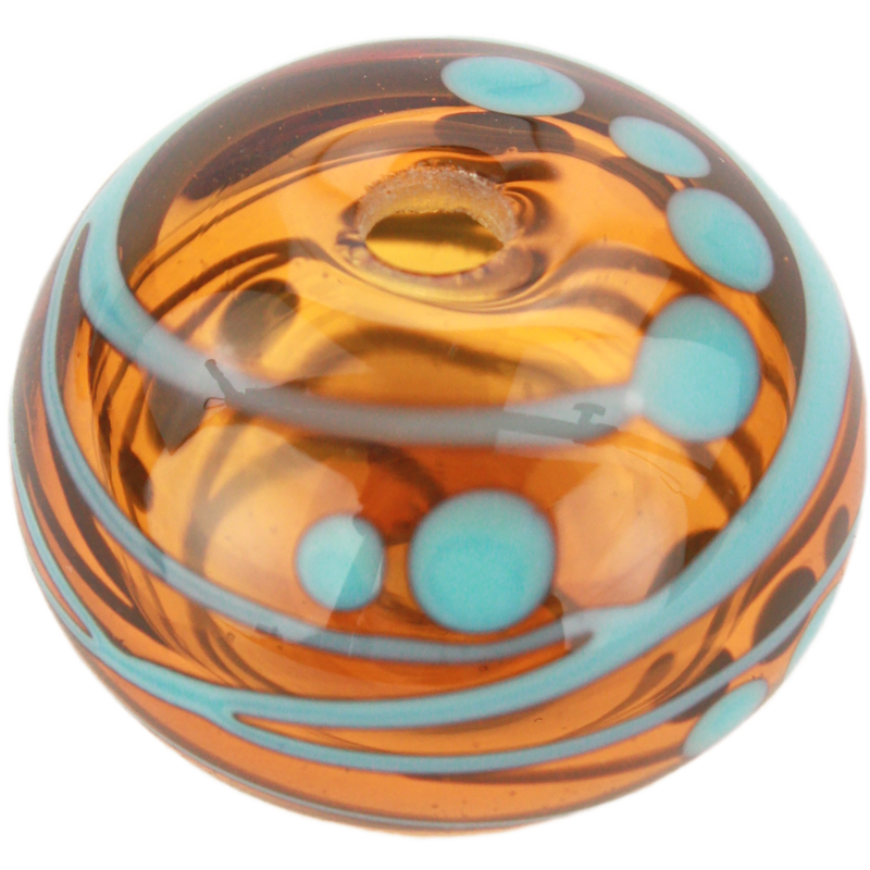 Transparent amber bead with turquoise stripes and dots