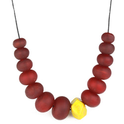 Necklace of hand blown and sandblasted hollow beads in rich deep red glass paired with a ochre yellow glass nugget bead and strung on adjustable leather