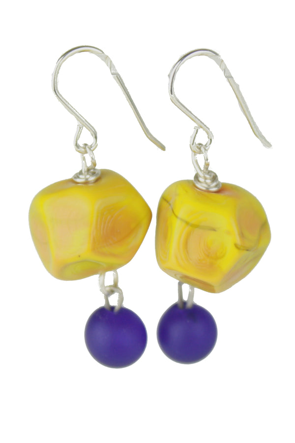 Nugget earrings featuring hand crafted ochre yellow glass hand faceted beads with a small cobalt blue glass charm