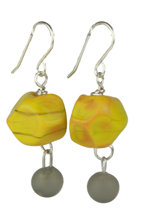 Nugget earrings featuring hand crafted ochre yellow glass hand faceted beads with a small grey glass charm