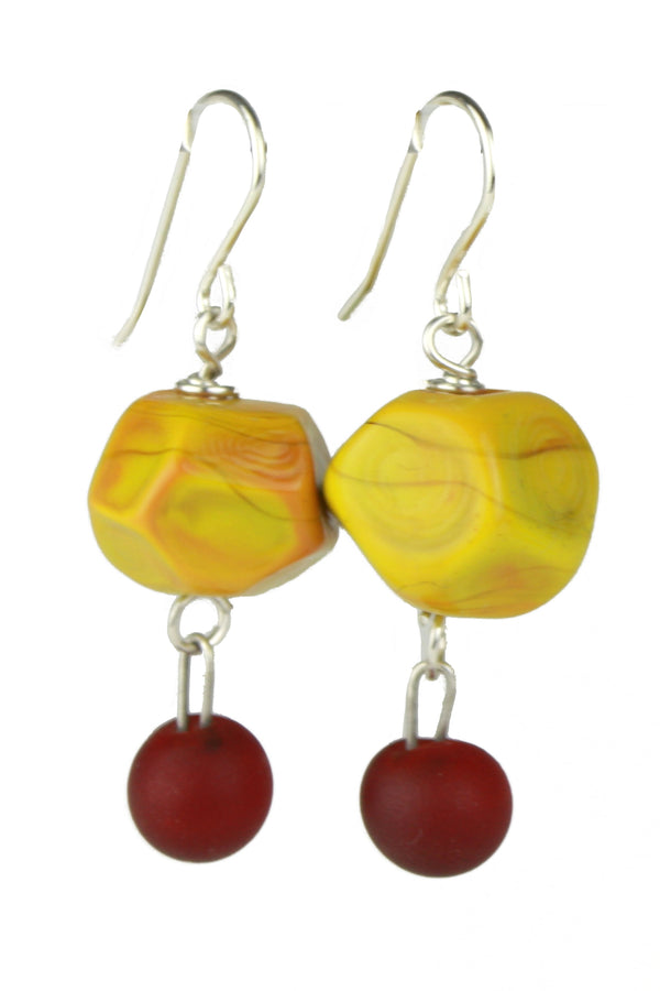 Nugget earrings featuring hand crafted ochre yellow glass hand faceted beads with a small deep red glass charm