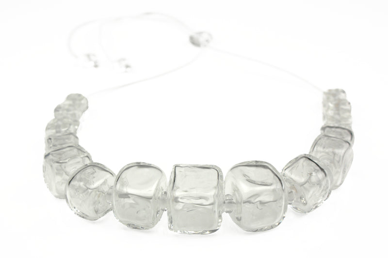 Necklace of hand blown cube shaped beads in crystal clear glass strung on adjustable leather
