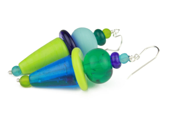 The frolic earrings are an asymmetrical mix of bright vivid colors and shapes of hand crafted glass beads.