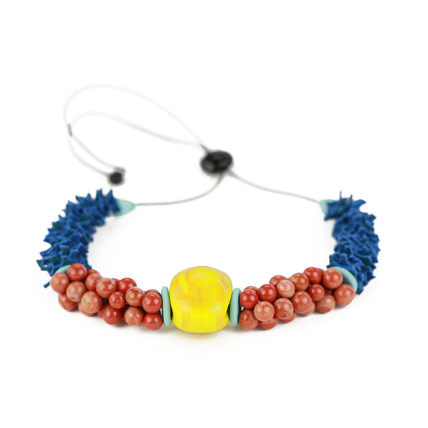 Textures necklace in yellow ochre, coral and blue