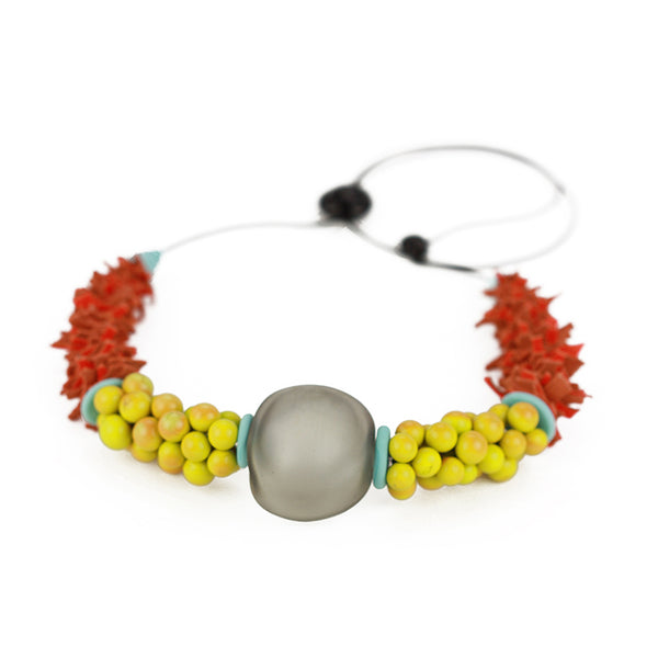Textures necklace in soft grey, yellow ochre and orange