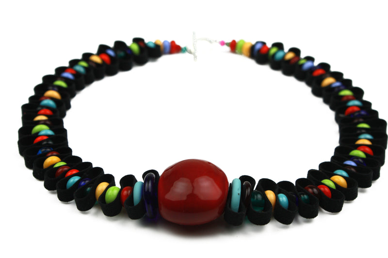 Hand crafted glass beads in a rainbow of vivid colours are interspersed with a velvety soft black ribbon.