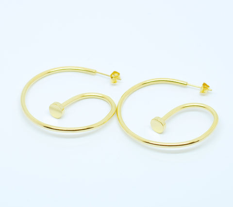 Gold nail earrings