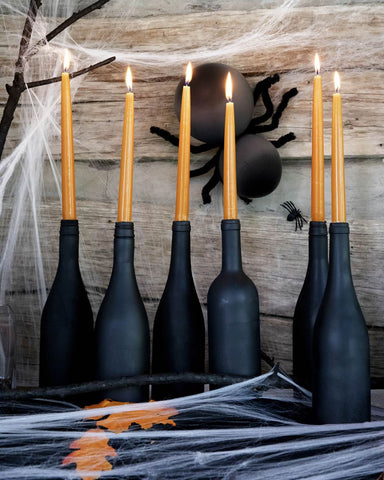 Wine Bottle Candlesticks by Country Living Staff