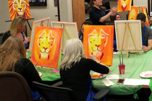 paint date corporate events: painting lion portraits