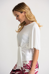 Joseph Ribkoff Top shirt blouse Front tie Sashed waistline rounded neckline ruffled short sleeves fitted falling at waist built-in dramatic sash tied on  front Slip on Color vanilla off white 202201 Womens Designer Clothing boutique shopping top fashion