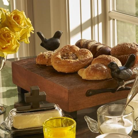 Jan Barboglio Las Golondrinas Charola Square Cutting Board Small square rough-hewn cutting board with cast iron bird handles and cube feet Hand hewn rough finish 2111 with Blessed Butter Covered Dish 1399 Dining Server