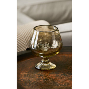 Barboglio The heavy hand-blown Lustre Brandy Glass Goblet has the feel of a chalice. The beautiful opalescent color dances in the light, and the laurel leaf etching in the middle gives it an Old World feel and would be a beautiful addition to your dining table, bar and home.  Can be used also for flowers, candy, and candle holder  Great gift  Dimensions 5x5x6 3145OP Glassware