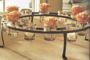 Jan Barboglio El Riel Redondo D' Mesa Candelabra is a cast iron circular rail with 12 mouth blown heavy rimmed clear glass vessels Great for votive candles flowers candy and much more 4245 Home Decor