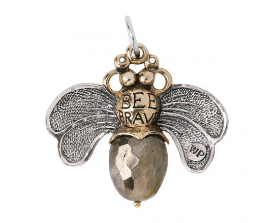 Waxing Poetic Bee Brave Honey Bee Pendant Sweet sentiments and good cheer help the whole hive hum.  A glorious twisted sterling silver wire wingspan carries an etched bee with the back side of the pendant reading BEE BRAVE. The body of the bee is a natural stone pyrite.  For a sophisticated take on the bee necklace, a Bee Brave Pyrite pendant from Waxing Poetic will be a modern addition to your collection Materials: Sterling Silver Brass Resin Charm Size: 1.25