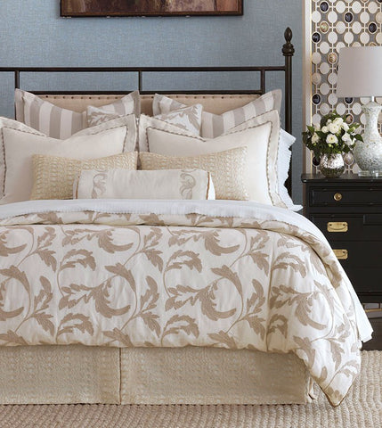 Bramble collection wistful summer days of woodland strolls and berry-picking with restful Bramble. Its neutral color palette emphasizes a depth of texture, from layered decorative pillows to a skilfully embroidered duvet cover. Fluttering foliages and a bold stripe come together in a collection that is at once measured and relaxed.  The price range for the Celerie Kemble Bramble luxury bedding depends on the bed size  Size ranges from Daybed to California King Custom Bedding
