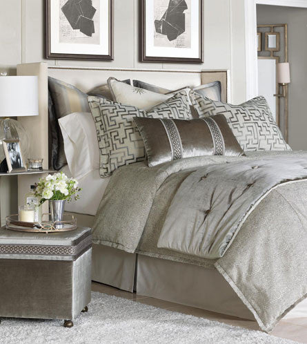 Eastern Accents Ezra Collection Let lustrous Ezra throw a glamorous glow over your bedroom Inspired by the ornate chandeliers and grand interiors of a magnificent ball, it is opulent in shining metallic tones and graceful lines. Whether your home is a lavish mansion or a stylish apartment, this collection will add an air of luxury and poise custom made in USA King BDK-376