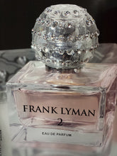Load image into Gallery viewer, Frank Lyman Perfume Title 2 A fresh floral harmony, created from a base of pure rose and jasmine extracts combined with hints of litchi and Mediterranean citrus fruits, gives this new scent a crisp and fruity aroma which is quite modern.  This fresh pink colored scent was created for the contemporary woman whose chic and elegance is not only elevated by her phenomenal sense of fashion, but also through the mesmerizing aromas her presence exhales.  Pure Eu D'Perfume From France  Size: 1.4 ounces