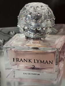 Frank Lyman Perfume Title 2 A fresh floral harmony, created from a base of pure rose and jasmine extracts combined with hints of litchi and Mediterranean citrus fruits, gives this new scent a crisp and fruity aroma which is quite modern.  This fresh pink colored scent was created for the contemporary woman whose chic and elegance is not only elevated by her phenomenal sense of fashion, but also through the mesmerizing aromas her presence exhales.  Pure Eu D'Perfume From France  Size: 1.4 ounces