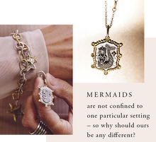 Load image into Gallery viewer, Waxing Poetic enchanted Lyric and Lore Charm trilogy beguiling mermaid is featured on the front surrounded by frame of brass dotted with Swarovski crystals a benediction FOLLOW THE LIGHT on revers mermaids LL2MS-MER Jewelry