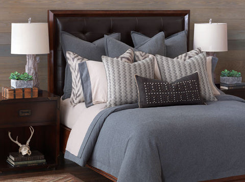 Transport yourself to a secluded alpine retreat with this refined take on classic lodge style. Inspired by the vast natural landscape of Barclay's favorite woodland getaways, this bedding program blends his signature poise with a timeless mountain aesthetic. Earthy sand and slate hues pair with 100% cotton flannel linens and faux leather accents to complete your very own sophisticated escape