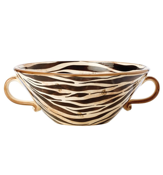 "Vietri Serengeti Handled Bowl The Serengeti handled bowl's classic colors of black, brown, and cream make the bold and exotic print versatile for both modern and traditional homes. Hand painted on terra bianca in Umbria. Decorative use only.  Measurements: 18""D, 6.5""H"