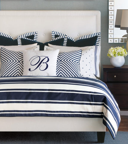 By seashore or lakeside, Barclay brings his own unmistakable flair to glamorous summertime living. From a skillfully mitered geometric pillow to its polka-dot embroidered shams, each piece is crafted with a precise attention to detail. Its diversity in texture and pattern is soothed by a classic blue and white color palette restful as a summer day