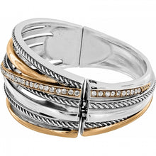 "Load image into Gallery viewer, Brighton Hinged Bangle Inspired by Neptune's five rings, our designer created this cleverly ""stacked"" bangle. Five rings are fused together, oval and hinged for comfort. A chic, hip look! Collection: Neptune's Rings  Width: 1 1/4"" Closure: Magnetic hinged Diameter: 2 1/4"" Material: Swarovski crystal Finish: Silver plated, Gold plated Price $82.00 Women's Designer Jewelry JF0111"