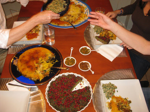 Three bowls of torshi on the table with a feast