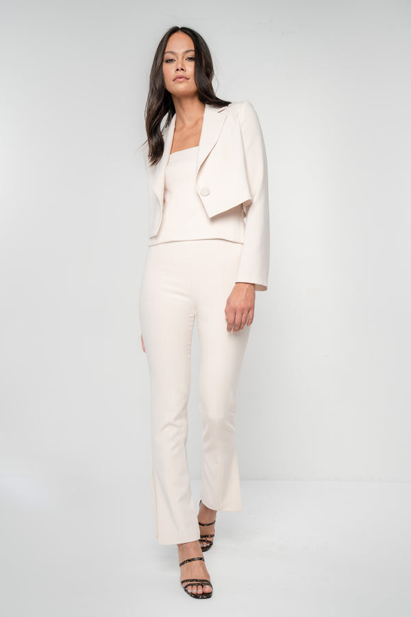 Cropped blazer with structured shoulders, full length flared sleeves, single button closure, slim fit. Custom made in a champagne woven stretch crepe fabric.