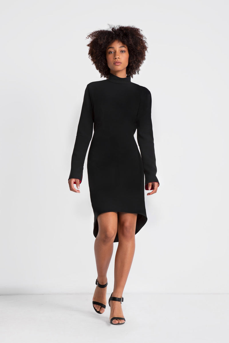 Classic little black dress featuring mock neckline, open cowl back, hi-low hemline, invisible zippers at sleeves. Made in a black triacetate fabric.