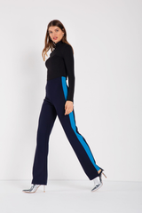 Fitted, high-waist navy coloured  pant with turquoise panels on either leg, cut-out detail along hem. Slight stretch, elastic waistband. Made in a woven stretch crepe fabric.