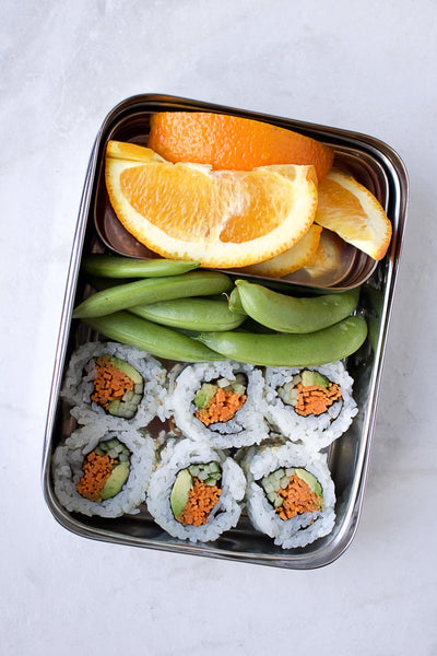 Sushi and orange slices