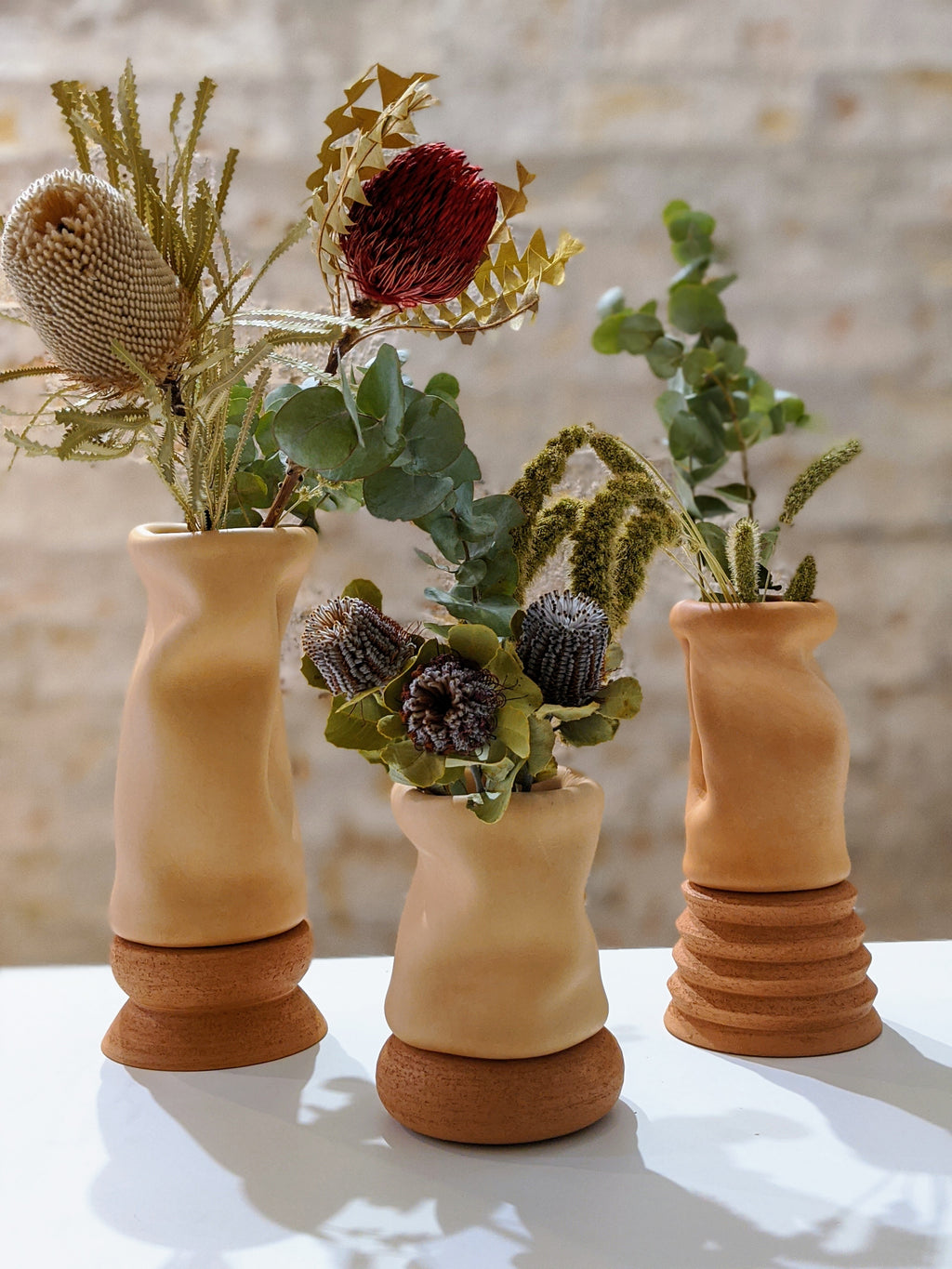 SHORT LEATHER AND TERRACOTA VASE