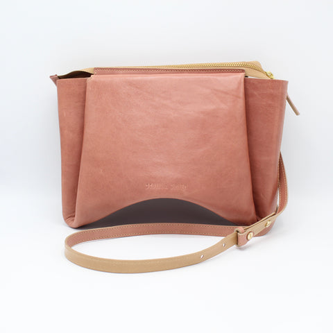 The Isa Bag. Smooth Guava/Buff. Zipper/Strap. Stitched.