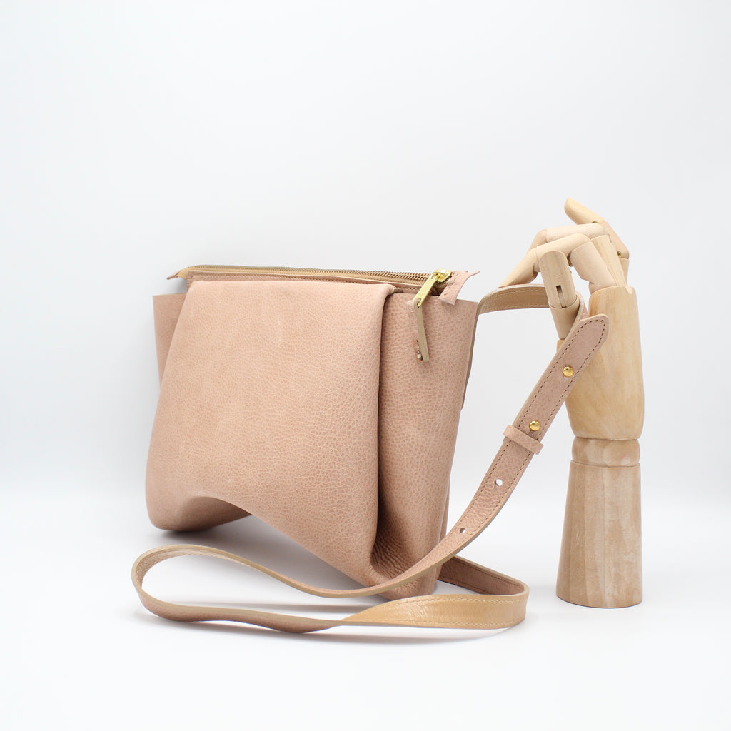 The Isa Bag. Powder Peony /Buff. Zipper/Strap.
