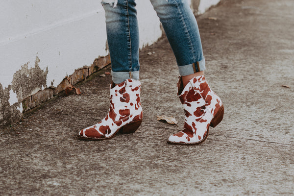 brown cow print western bootie