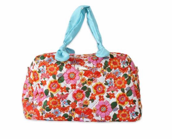 packed party on the grow quilted travel bag