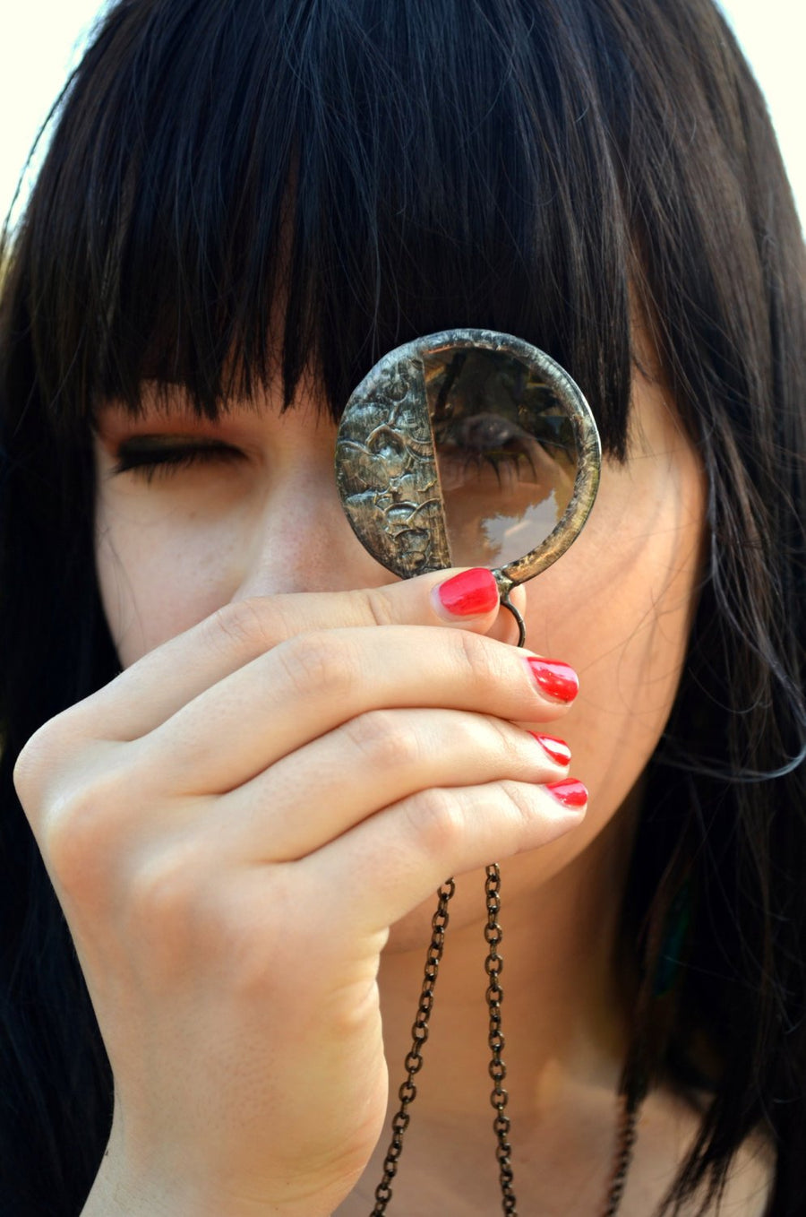 Model looking through Steampunk magnifier