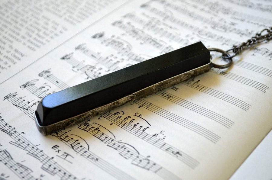 Piano Key Necklace on Sheet Music